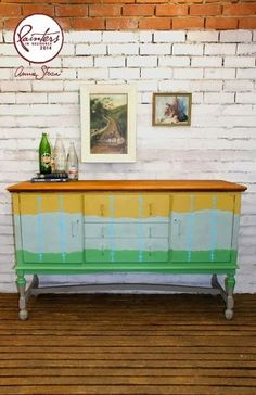 Buffet redo using Coco, Antibes Green, and Duck Egg Blue Chalk Paint® along with a custom Chalk Paint® mustard tone by Annie Sloan Painter in Residence Beau Ford of Drip Designs Furniture. The detail was created by using an artists brush and Greek Blue Chalk Paint®.
