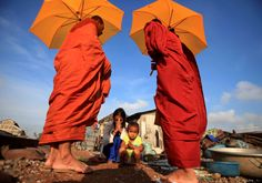 Image of the day © Samrang Pring/Reuters   Wednesday, December 3: A mother and her daughter pray A woman and her daughter pray after offering alms to Buddhist monks near a railway track in Phnom Penh, Cambodia, December 2, 2014.
