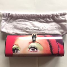 Jimmy Choo Face Clutch This oblong clutch is perfect for a night out. It's a great conversation starter and exceptionally unique. Flip clutch on either side to have a bright flirty bag or a moody, mysterious one! Jimmy Choo Bags Clutches & Wristlets
