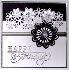 Die'sire edgeables floral dance cut in white cardstock and matted onto black