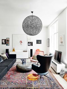 love the persian rug in a modern space