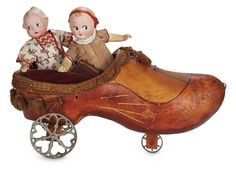 Two German Bisque Googlies with Amusing Expressions in Wooden Shoe Pull Toy 800/1200 Auctions Online | Proxibid