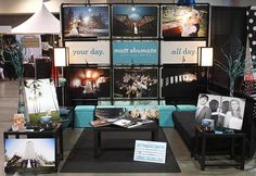 photography bridal show booth idea    LOVE the backwall idea! Could do that with PVC and wire. Also love the blue totes she uses to haul items with and doubles as booth decor! Probably wouldn't do a couch or the coffee table. May do the two end tables, the one big rectangular table with a tablecloth that the show offers, two chairs where the couch is, and get some pretty fancy lamps. !