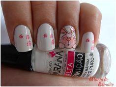 Feliz Páscoa: http://blog.maniadeesmalte.com.br/2012/04/nail-art-coelho-feliz-pascoa.html