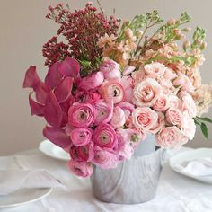 Monochromatic arrangements. Love way flowers are separately grouped together.  Floral Centerpieces : Tips & Ideas - Celebrate Magazine