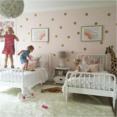 Twin girls room with polka dot walls