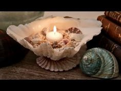 Interior Design DIY project. San Diego Interior Designer Rebecca Robeson and Greyson Darrow walk you through the steps to creating your own one-of-a-kind candles using seashells. In a recent video Rebecca made a simple candle by melting a votive candle in the microwave oven and pouring down the throat of a seashell. The response from YouTube sub...