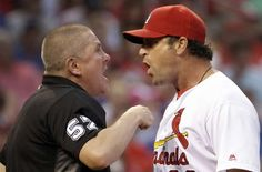 See ya later: St. Louis Cardinals manager Mike Matheny, right, argues with home plate umpire Mike Everitt after being ejected during the sixth inning of the team's baseball game against the Kansas City Royals on June 30 in St. Louis.