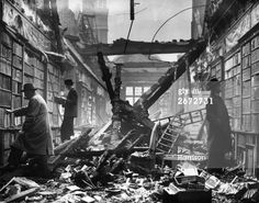 Readers choosing books which are still intact among the charred timbers of the Holland House library, London. (Photo by Harrison/Getty Images) 1940-1949