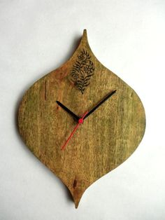 http://www.afday.com/collections/lamps/products/wood-carving-wall-clock  Rs 750