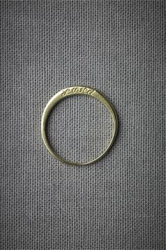 Image via: BHLDN. This gives me an idea of what to do w the bands I have...maybe melt them down and have her/their initials or date engraved. if extra gold could have one made for a necklace.