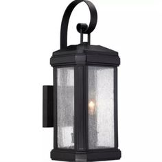 The Trumbull - Outdoor Wall Mount by Quoizel Lighting features a design inspired by the rich outdoors, the Trumbull Collection features clear seedy glass and a deep Mystic Black finish.A strong, substantial design with great curb appeal. Visit PatioProductsUSA.com to purchase now! #outdoorpatiolight #outdoorporchlighting #outdoorlighting Black Outdoor Wall Lights, Outdoor Wall Lantern, Outdoor Wall Sconce, Outdoor Wall Lighting, Exterior Lighting, Wall Sconce Lighting, Outdoor Walls, Wall Sconces, Coastal Lighting