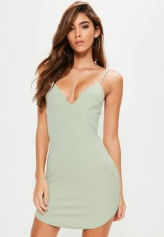 Score some new and be a basic babe in this sage green dress - featuring a plunge neck, strappy back and a bodycon fit.