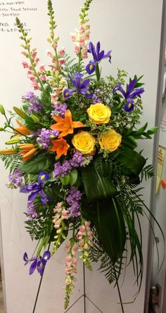 Floral spray with iris, snapdragons & yellow roses