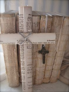A cross, wrapped in old book pages, joined with jute.  Petite Michelle Louise: White Wednesday