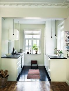 black floor and countertops, white cabinets and walls