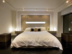 Designer's Notes The custom wood headboard and nightstands are backlit with LED lighting in a cove cut-out as well as around the perimeter of it. A balcony with views to the Georgetown canal is to the right. Contemporary Bedrooms