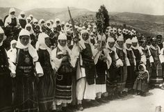 Dozens of women in ornate traditional dress armed with rifles. 1910S Epirus, Greece. Photographer: HENRY RUSCHIN/National Geographic Creative