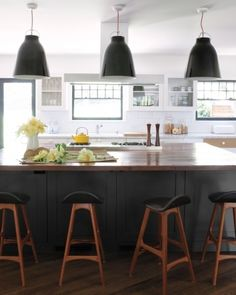 Black island with butchers block counter top. (White cabinets with marble- ish countertops)