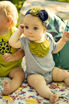 cute baby headband and onesie.