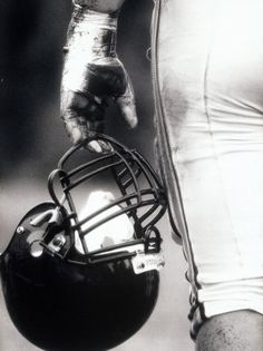 Angle View of An American Football Player Holding a Helmet Photographic Prin.Low Angle View of An American Football Player Holding a Helmet Photographic Prin. Football Senior Pictures, Football Poses, Sports Football, American Football Players, Sports Pictures, Senior Photos, Football Art, Football Season, Football Tattoo