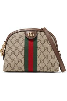 29222b81f75 Shop the Ophidia GG shoulder bag by Gucci. Crafted in GG Supreme canvas  with inlaid Web stripe detail