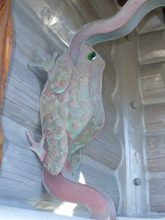 Our cool frog downspout looks so pink and green. The beauty of copper is so magical.