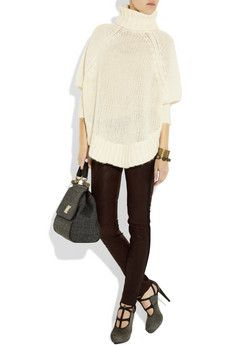 Loving all oversized poncho style sweaters. Michael Kors