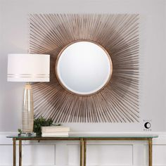 """Sturdy iron rods alternating in length and gauge, finished in a distressed copper leaf, come together to forge two timeless shapes. Mirror has a generous 1 1/4"""" bevel. - 42 W x 42 H x 1"""" D - Oversized"""