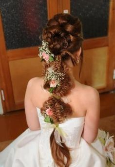 Intricate wedding braid with a bun and flowers
