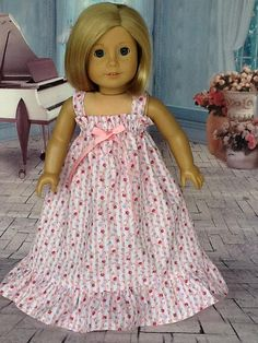 This can be a hostess gown or nightgown. For this dress, I used a pink and white striped cotton fabric with tiny rosebuds and flowers. It has a gathered top with straps and elastic casing that forms the top ruffle. I added a pretty pink bow in the center front. A really full ruffle at
