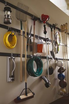 Rubbermaid, as well as a few other companies, make systems that you can hang on the wall to organize tools, garden supplies and other items in the garage. You just mount the system and use hooks to hang things up. This is a great way to make more floor space in the garage and keep it well-organized at the same time