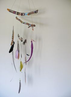 beautiful twig and feathers mobile. DIY project. painted colours