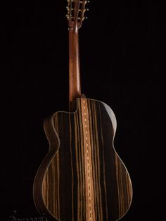 This stunning OMSC from Bourgeois is the only 12 fret model they make and they do it right. We customized this with beautiful premium tonewoods, soft cutaway, tile rosette, Ebony bindings, hide glue construction and more. A rich, striped set of Premium Macassar Ebony makes up the back and sides and a premium set of Italian Spruce (oneof our favorite top woods) makes up the top. The Mahogany slotted headstock with Macassar Ebony overlay tops off this classy heirloom quality instrument. Other…