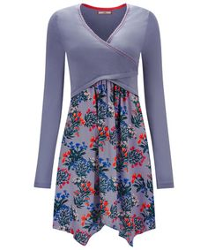 027e9a92b31 Be transported to a wildflower meadow with this daydream of a tunic. A  flattering mock