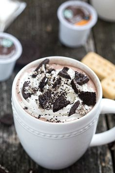 Easy Cookies 'n Cream Hot Chocolate Recipe - Ultra creamy and decadent! Made in only a few minutes and topped with whipped cream and chopped up chocolate cookies! Semi-homemade!