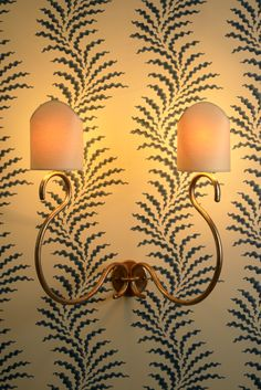 New Soane Britain designs, The Scrolling Wall Light backed by Scrolling Fern Frond Wallpaper in Azure. Picture Lights, Picture Wall, Fern Frond, Wall Lights, Ceiling Lights, Pretty Bedroom, British Colonial, Fabric Wallpaper, Solar Lights