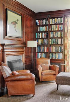 Antique leather club chairs and a floor lamp from the 1960s, both from Balsamo in New York, offer a comfy reading spot in the library