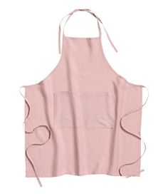 Dusky pink. PREMIUM QUALITY. Apron in woven linen fabric with a hemmed edge, ties at waist and at neck, and two front pockets. Tumble drying will help keep