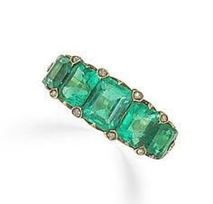 An emerald five-stone ring, circa 1865  The graduated half-hoop of step-cut emeralds, highlighted with rose-cut diamond points, to a scrolling gallery, mounted in yellow gold