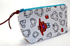 Handmade Baymax Fabric Cosmetic Make-up Bag / Pencil Case by CabbyCraft on Etsy https://www.etsy.com/listing/225507073/handmade-baymax-fabric-cosmetic-make-up
