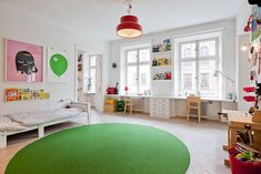 Large kid's room in white with green contrasts and yellow, pink, red and nature accents