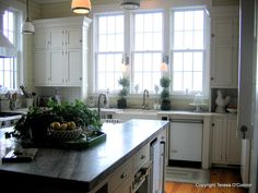 Love this kitchen and island centerpiece too!
