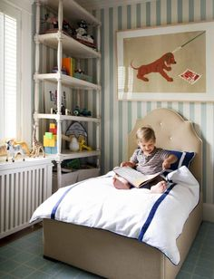 Erika Ward of Blu Label .. boys bedroom...tall bookcase, stripes on wall, framed print