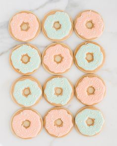 """Peach and Mint """"Donut"""" cookies for a baby gender reveal brunch for Lemon and Lime Event Design @lemonandlimeeventdesign _ #donutcookies #babybrunch #skcookies #SweetKiera #babyshowercookies"""