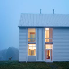 Modern minimalist farmhouse White exterior siding with movable screens A farmhouse in PA by Cutler Anderson Architects Architecture Résidentielle, Minimalist Architecture, Farmhouse Architecture, Transitional Living Rooms, Transitional House, Transitional Lighting, Farmhouse Homes, Modern Farmhouse, White Farmhouse
