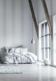 White room with large windows.