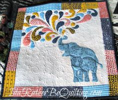 Just a little baby quilt featuring elephants in gray and yellow ... : jungle theme baby quilt patterns - Adamdwight.com