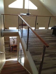 The perfect choice in #railing to keep this loft space open and airy. Clearview® Cable #RailingSystem (shown with Wood Top Rail).