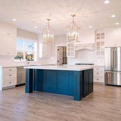 Kitchen island: Ben Moore Hale Navy; walls: Ben Moore Simply White; trim: Behr Ultra Pure White; cabinets: Behr Swiss Coffee;